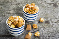 Sweet Caramel Popcorn In Two Ceramic White Striped Blue Bowls On A Stylish Gray Stone Background. Selective Focus. Royalty Free Stock Photography - 99153047