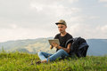 Young Male Hiker Uses Tablet Pc On Vacation Royalty Free Stock Image - 99153416