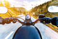 Motorcycle Driver Riding In Alpine Highway, Handlebars View, Austria, Europe. Royalty Free Stock Photo - 99155155