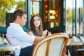 Couple Drinking Coffee And Eating Croissants In Paris, France Royalty Free Stock Images - 99156469