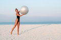 Fitness Woman With Fit Ball On Beach Outdoors. Stock Image - 99184781