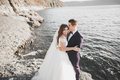 Happy And Romantic Scene Of Just Married Young Wedding Couple Posing On Beautiful Beach Royalty Free Stock Image - 99194986