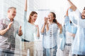 Elated Cheerful Colleagues Standing In The Office Royalty Free Stock Image - 99202686