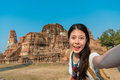 Pretty Happy Girl Student Standing On Ayutthaya Stock Images - 99206224