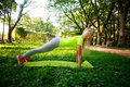 Young Sporty Woman Doing Fitness Push-ups In Green City Park Royalty Free Stock Photo - 99212525