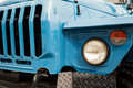 Blue Truck Front Close-up With Radiator Grille And Headlights Stock Photos - 99224933