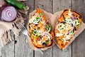 Baked, Stuffed Sweet Potatoes,  Above View On Rustic Wood Stock Photo - 99234730