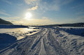Snowy Road With Tromsoe City Island In The Background At Sunrise Stock Photo - 99237620