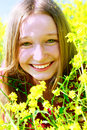 Happy Girl In Yellow Flowers Royalty Free Stock Photo - 9943165
