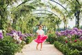 Pretty Little Girl Playing In A Beautiful Garden Stock Photos - 99671853