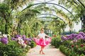 Pretty Little Girl Playing In A Beautiful Garden Royalty Free Stock Photography - 99672117