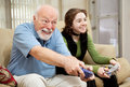 Senior Man Playing Video Games Stock Photography - 9994492