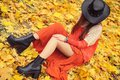Pretty Young Woman Posing In Autumn Park, Leather Hat Royalty Free Stock Photo - 99911425