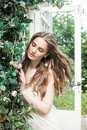 Beautiful Woman In Spring Rose Garden Outdoors Royalty Free Stock Image - 99943226