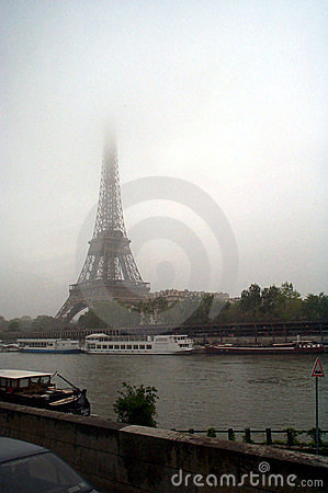 Eiffel tower against cloudy skies