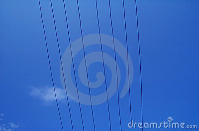 Electrical wires against blue sky