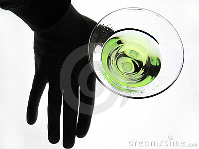 Hand holding glass of Martini