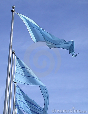 Blue flags on a blue sky