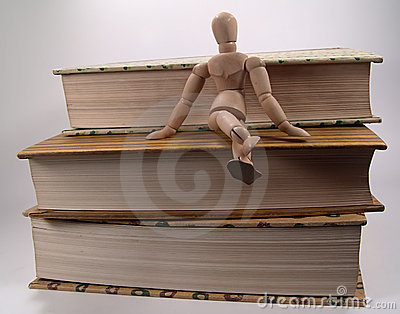 Mannequin Sitting on Books