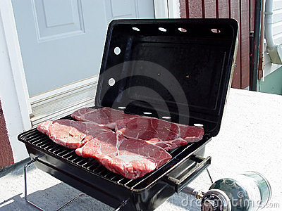 Steaks on a barbaque