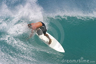 Surfer Surfing on a White Surfboard