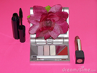 Cosmetics Collection With Pink Flower