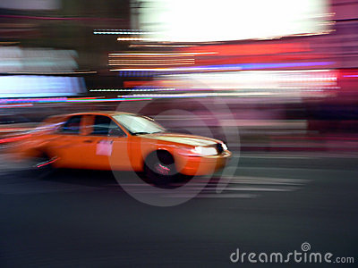 Taxi speeds through the streets