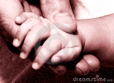 Mans hand holding baby hand2