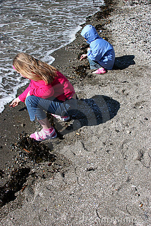 Girls playing on sandy beach