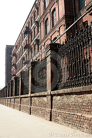 Monumental, old factory behind the wall