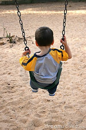 Boy On A Swing At The Park