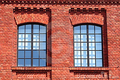 pair of Windows in red brick  wall
