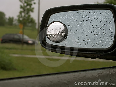 Rain on car mirror 19