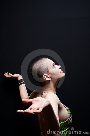 Bald girl looking up