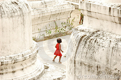Small Girl Playing Hide and Seek at Buddhist Temple