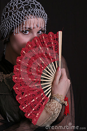 Shy woman with fan
