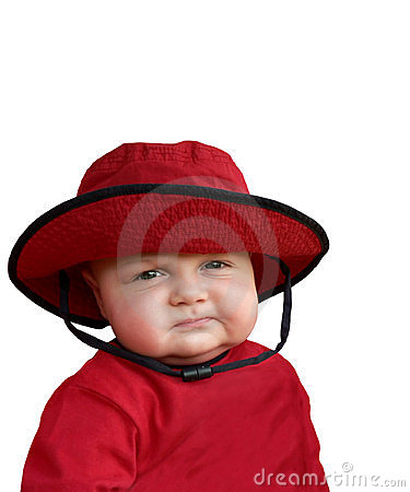 Skeptical baby in red hat.