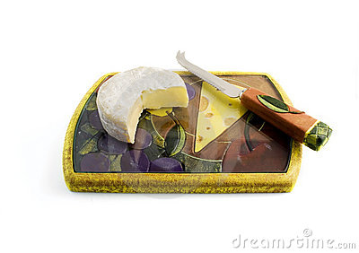 Cheese on a board with knife