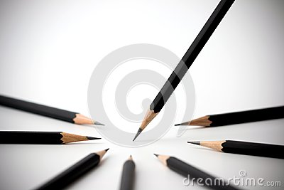 Black pencil standing out from crowd of plenty identical black fellows. business success concept.