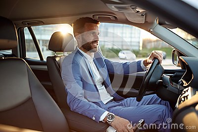 Businessman going on business trip by car
