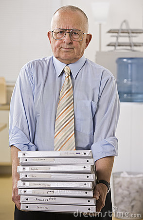 Man Holding Binders