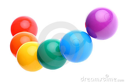 Six shiny coloured plastic toy balls isolated