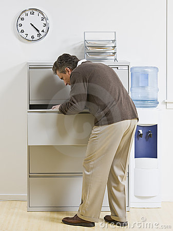Man Looking Through Drawer