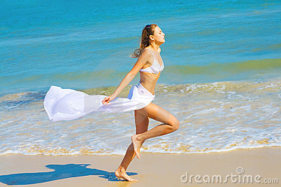 Girl in white running