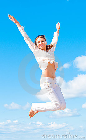Girl in white jumping