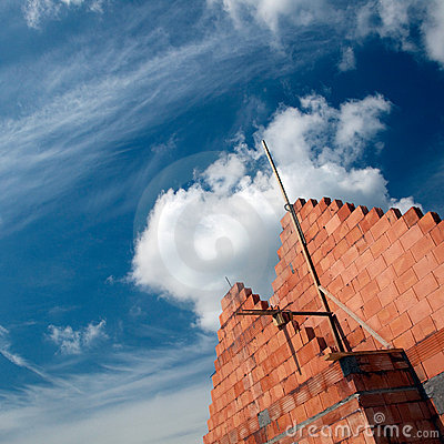 Brick building and cloudscape