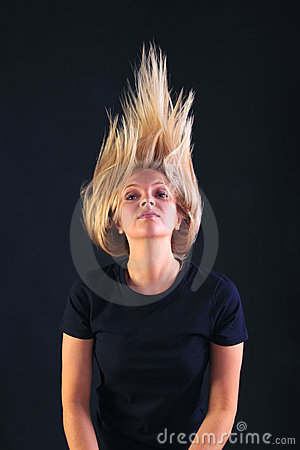 Blond woman throwing her head back