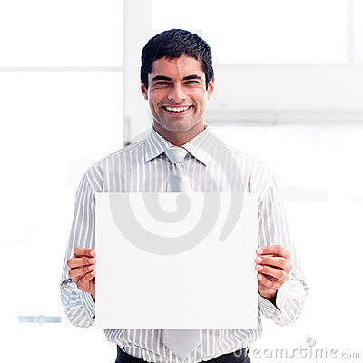 Portrait of a smiling businessman holding a white