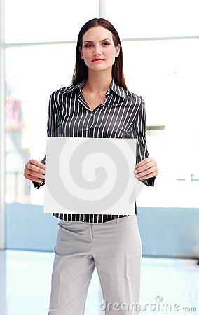 Confident woman showing a big business card