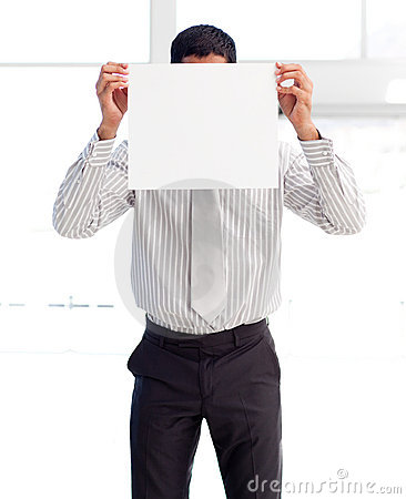 Businessman showing a white card covering his face